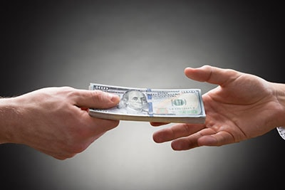 Two People Hands with Money